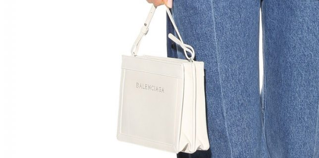 Balenciaga Classic and Chic Perforated Logo Clutch with Strap