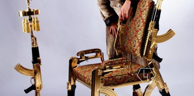 A designer gold plated chair made from six AK-47 rifles